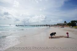 Kids playing in the sand at Carlisle Bay Beach in Bridgetown Barbados.jpg