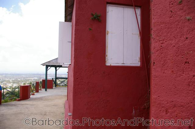 Red stucco and white shutter of Gun Hill Signal Station in Barbados.jpg