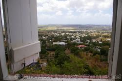 Looking out through a window at the Gun Hill Signal Station tower in Barbados.jpg