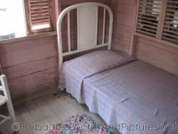 Small bed in a cottage at Tyrol Cot in Barbados.jpg